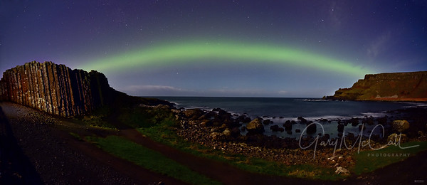 Aurora Borealis bridging the Giants Causeway and Lacada Point