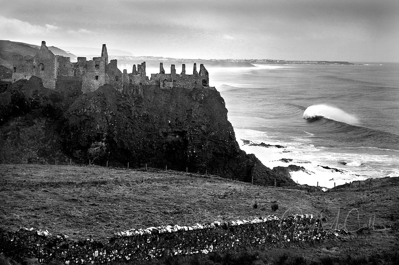 Record breaking swell hitting Dunluce Castle , County Antrim
