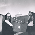 Two Immaculate Heart of Mary sisters stand outside the Cathedral of St. Thomas More in Arlington in this undated file photo.