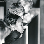 A St. Thomas More Cathedral School student attends a Mass for peace in 1991.