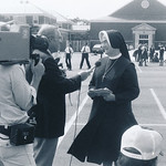 A sister is interviewed by a television crew from channel 7 outside the cathedral school in 1979.