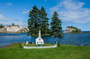 A miniature church sits beside the Bras d'Or Lake at Plaster Cove near Iona. The islands in the background are composed almost entirely of gypsum