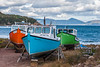 Fishing boats hauled up on the shore at Smelt Brook, a fishing village on the Cabot Trail in northern Cape Breton