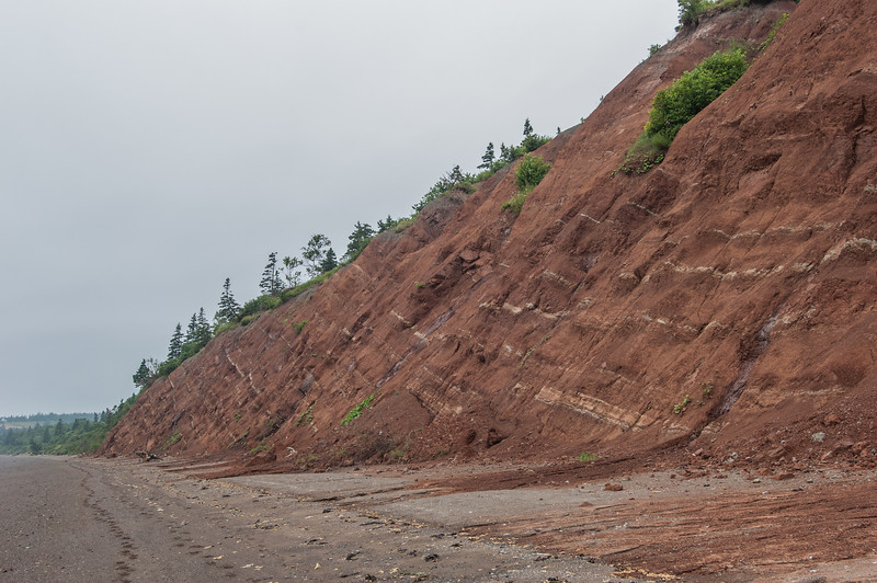 View of the cliffs and shoreline at Clark's Head outside the town of Parrsboro. This area is a hot bed for fossil hunters and rock hounding. The man in some of the images is Ken Adams, director of the Fundy Geological Museum