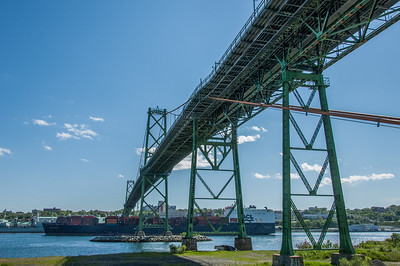 A container ship passes under the Angus L. MacDonald bridge on its way out of Halifax Harbour