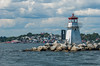 Lighthouse at the entrance to Lunenburg Harbour with the town in the background
