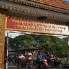 Traffic on road under gate, Krong Siem Reap, Siem Reap, Cambodia