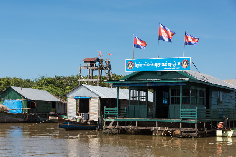 Cambodian flags at building on stilts on Tonle Sap lake, Kampong Phluk, Siem Reap, Cambodia