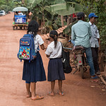 People standing on street in village, Siem Reap, Cambodia