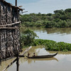 Elevated view of children rowing boat in Tonle Sap Lake, Kampong Phluk, Siem Reap, Cambodia