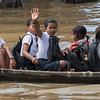 Students on their way to school by boat in Tonle Sap lake, Kampong Phluk, Siem Reap, Cambodia