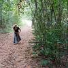 Woman walking on dirt road, Siem Reap, Cambodia