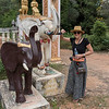 Portrait of happy woman standing near elephant sculpture at temple, Siem Reap, Cambodia