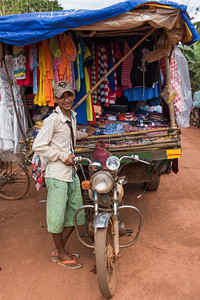Portrait of man selling clothes at market, Siem Reap, Cambodia