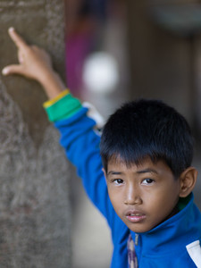 Portrait of boy pointing to a wall, Krong Siem Reap, Siem Reap, Cambodia