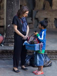 Boy selling bag to woman, Krong Siem Reap, Siem Reap, Cambodia
