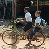 Side view of two boys on bicycle, Siem Reap, Cambodia