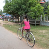 Rear view of girl riding bicycle, Changwat Ubon Ratchathani, Cambodia