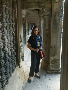 Portrait of happy woman standing at temple, Krong Siem Reap, Siem Reap, Cambodia
