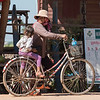 Woman with her daughter on bicycle, Siem Reap, Cambodia