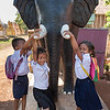 Children playing on statue at temple complex, Siem Reap, Cambodia