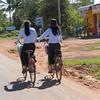 Rear view of two women riding bicycles, Damdek, Siem Reap, Cambodia