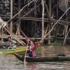 Woman rowing a  boat in Tonle Sap lake, Kampong Phluk, Siem Reap, Cambodia