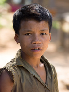 Portrait of local adolescent boy, Ban Houy Phalam, Laos