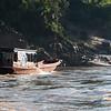 Houseboat travelling along the River Mekong, Laos
