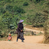 People walking on dirt road, Ban Houy Phalam, Laos