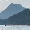 Silhouette of people on boat in River Mekong, Laos