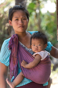 Young mother carrying her baby, Sainyabuli Province, Laos