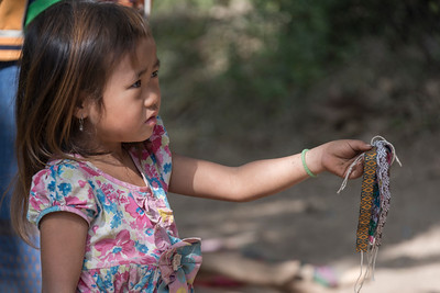 Little girl selling wrist bands, Sainyabuli Province, Laos