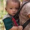 Girl carrying her baby brother on sling, Sainyabuli Province, Laos