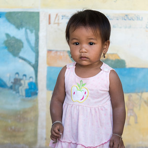 Portrait of local girl toddler posing for camera, Sainyabuli Province, Laos