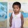 Portrait of local girl toddler posing for camera, Sainyabuli Province, Laos
