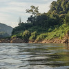 Scenic view of river shoreline with mountain range in background, River Mekong, Sainyabuli Province, Laos