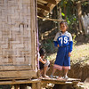 Portrait of local adolescent girl standing outside a hut, Ban Houy Phalam, Laos