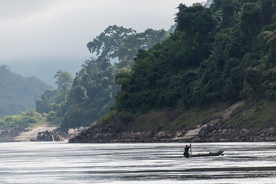Fisherman with his net in River Mekong, Laos