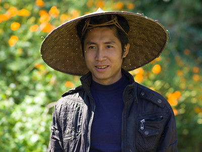 Happy man wearing Asian style conical hat, Luang Prabang, Laos