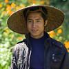 Happy man wearing Asian style conical hat, Luang Prabang, Laos