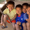Portrait of four boys sitting together, Ban Houy Phalam, Laos