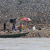 People and boat along shoreline, River Mekong, Laos