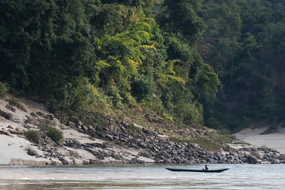 Person in a boat in River Mekong, Sainyabuli Province, Laos