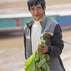 Portrait of man holding leaf vegetable, Sainyabuli Province, Laos
