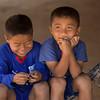 Happy boys sitting on a hammock, Ban Houy Phalam, Laos