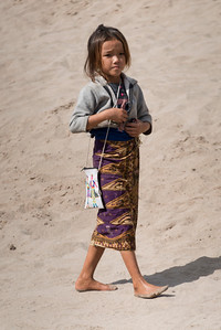 Girl walking on sand, Sainyabuli Province, Laos