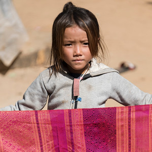 Portrait of local girl holding shawl, Sainyabuli Province, Laos
