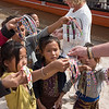 Children selling wrist bands to tourists, Sainyabuli Province, Laos
