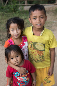 Portrait of group of three children, Ban Gnoyhai, Luang Prabang, Laos